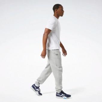 Мягкие и удобные спортивные брюки TRAINING ESSENTIALS CUFFED по сниженной цене
